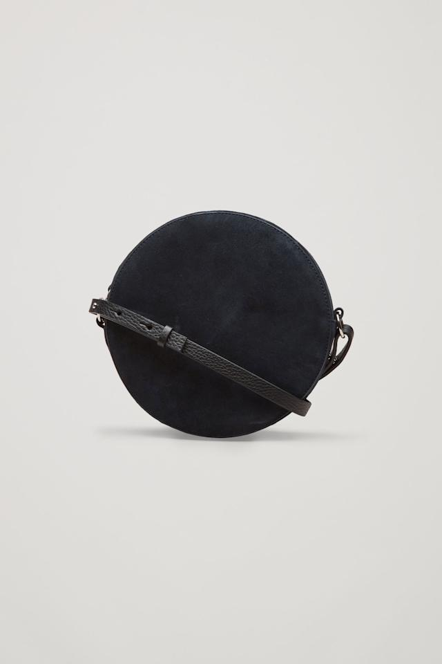 "<div>Circular shoulder bag - <a rel=""nofollow"" href=""http://www.cosstores.com/gb/Women/Bags_Purses/Circular_shoulder_bag/10672447-73695273.1#73695276"">£79</a></div>"