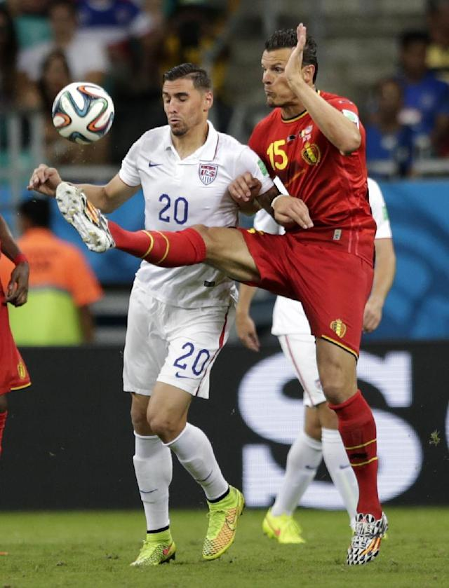 Belgium's Daniel Van Buyten, right, clears the ball from United States' Geoff Cameron during the World Cup round of 16 soccer match between Belgium and the USA at the Arena Fonte Nova in Salvador, Brazil, Tuesday, July 1, 2014. (AP Photo/Julio Cortez)