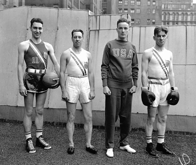 Official uniforms for U.S. athletes in the Olympic Games at Berlin, shown at sporting goods house, A.G. Spalding & Co. in New York on July 5, 1936. Left to right: uniforms for basketball, track, yachting and boxing. (AP Photo)