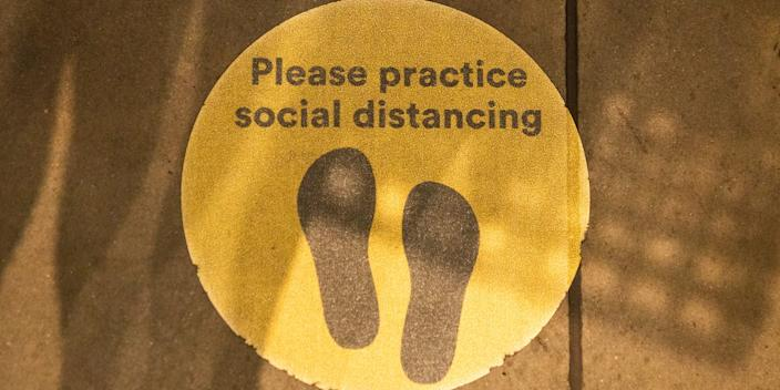 A sign reminding people to socially distance in New York City.