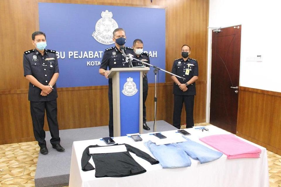 District police chief Assistant Commissioner Mohd Zaidi Abdullah (centre) with the seized items during a press conference in Kota Kinabalu June 21, 2021.