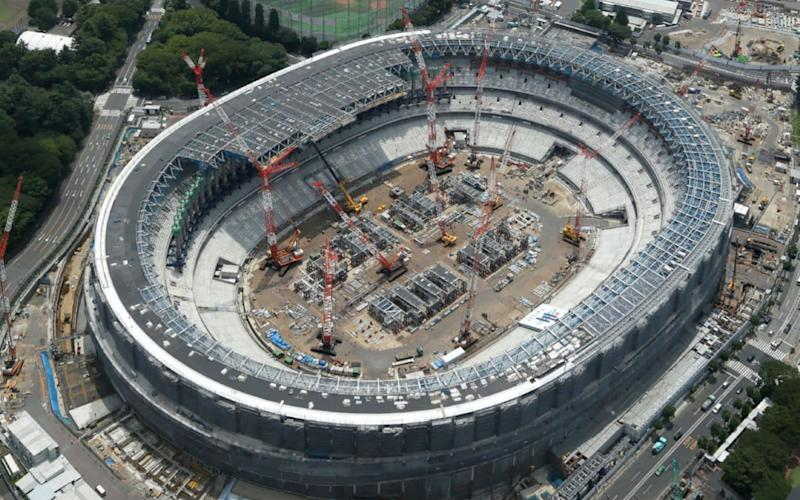 An aerial view of Japan's National Stadium under construction in Tokyo for the upcoming Tokyo 2020 Olympic Games - AFP