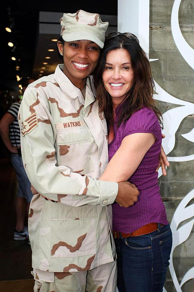 "Former supermodel Janice Dickinson shows her Veterans Day spirit by hugging it out with a female soldier on trendy Robertson Boulevard in Los Angeles. Pedro Andrade/Bret Thompsett/<a href=""http://www.pacificcoastnews.com/"" target=""new"">PacificCoastNews.com</a> - November 11, 2009"