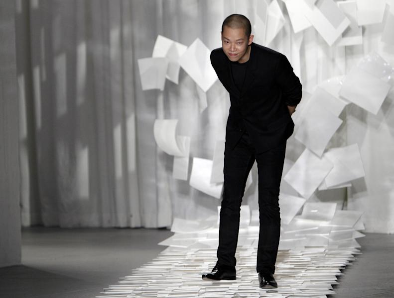 "FILE - In this Sept. 9, 2011 file photo, designer Jason Wu takes a bow after presenting his Spring 2012 collection during Fashion Week in New York. Wu may have won international recognition for twice designing inaugural gowns for U.S. first lady Michelle Obama, but judges in his native Taiwan seem unimpressed. Taiwan's Intellectual Property Court ruled Monday, Jan. 21, 2013 that Wu's new label ""Miss Wu"" could not be registered as a brand because it was not distinctive enough. He designed Michelle Obama's white inaugural gown in 2008. On Monday, she appeared in another of his creations, a shiny gown with a red halter top. (AP Photo/Mary Altaffer, File)"