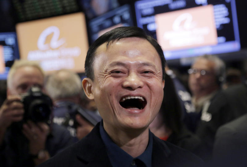 FILE - In this Sept. 19, 2014, file photo, Jack Ma, founder of Alibaba, smiles during the company's IPO at the New York Stock Exchange in New York. Remarks by Ma, one of China's richest men, that young people should work 12-hour days, six days a week if they want financial success have prompted a public debate over work-life balance in the country. (AP Photo/Mark Lennihan, File)