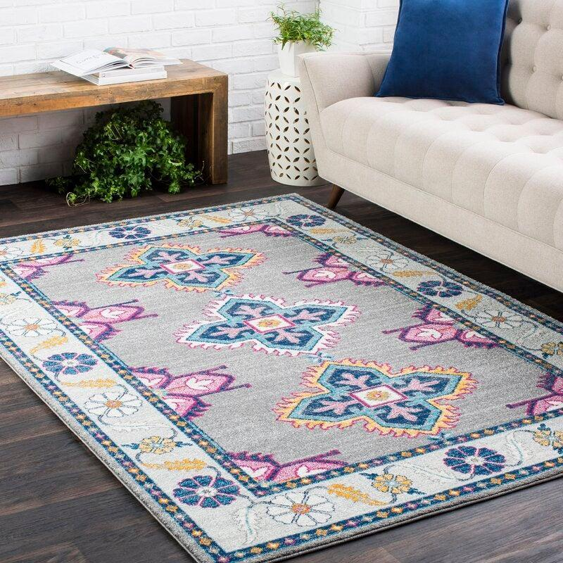 """<h2>Bungalow Rose Arteaga Area Rug</h2><br><strong>Deal: 69% off</strong><br>With 4.8 out of 5 stars and over 2,000 reviews, this statement rug is a certified fan favorite. <br><br>""""To tell you I was SO incredibly excited to get my rug is an understatement. When it arrived and I opened the package, it did not disappoint!!! The colors are vibrant and fun, the size is perfect and the rug is plusher than I was expecting, which makes for such a cozy feel. Who doesn't want that? I have been looking for a beautiful rug to ground my family room space and I am so happy that I got exactly what I wanted. Totally worth every penny!"""" <em>– <a href=""""https://www.wayfair.com/rugs/pdp/bungalow-rose-arteaga-navygrayy-area-rug-bgrs1357.html"""" rel=""""nofollow noopener"""" target=""""_blank"""" data-ylk=""""slk:Amy, Wayfair Reviewer"""" class=""""link rapid-noclick-resp"""">Amy, Wayfair Reviewer</a></em><br><br><br><em>Shop</em> <strong><em><a href=""""https://www.wayfair.com/brand/bnd/bungalow-rose-b37700.html"""" rel=""""nofollow noopener"""" target=""""_blank"""" data-ylk=""""slk:Bungalow Rose"""" class=""""link rapid-noclick-resp"""">Bungalow Rose</a></em></strong><br><br><strong>Bungalow Rose</strong> Arteaga Area Rug, $, available at <a href=""""https://go.skimresources.com/?id=30283X879131&url=https%3A%2F%2Fwww.wayfair.com%2Frugs%2Fpdp%2Fbungalow-rose-arteaga-graydark-blueteal-area-rug-w004313574.html"""" rel=""""nofollow noopener"""" target=""""_blank"""" data-ylk=""""slk:Wayfair"""" class=""""link rapid-noclick-resp"""">Wayfair</a>"""