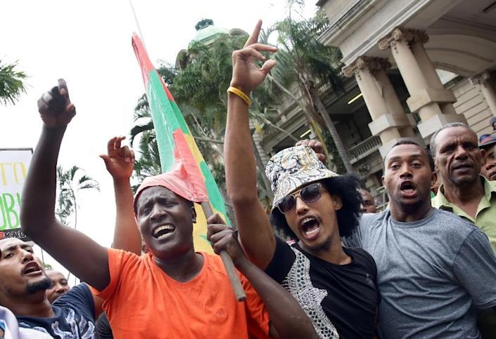 Demonstrators take part in an anti-xenophobia march outside the City Hall of Durban on April 8, 2015 (AFP Photo/Rajesh Jantilal)