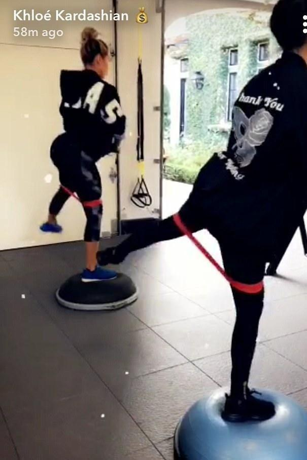 Khloe shared to her fans a video of her pregnancy workout which included using resistance bands. Source: SnapChat
