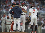 Atlanta Braves pitcher Ian Anderson, third from left, speaks with pitching coach Rick Kranitz, second from left, in the first inning of a baseball game against the Philadelphia Phillies Saturday, May 8, 2021, in Atlanta. (AP Photo/Ben Margot)