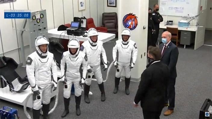 The Crew-2 astronauts (left to right), Thomas Pesquet, Megan McArthur, Shane Kimbrough and Akihiko Hoshide, chat with SpaceX founder Elon Musk (foreground right) and NASA acting Administrator Steve Jurzyck before walkout to the launch pad. / Credit: NASA TV