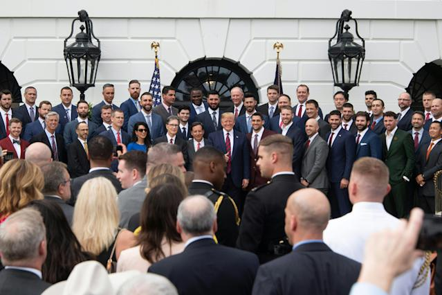 US President Donald Trump (C) poses with the 2018 World Series Champions Boston Red Sox at the White House in Washington, DC, on May 9, 2019. (Photo by Jim WATSON / AFP) (Photo credit should read JIM WATSON/AFP/Getty Images)