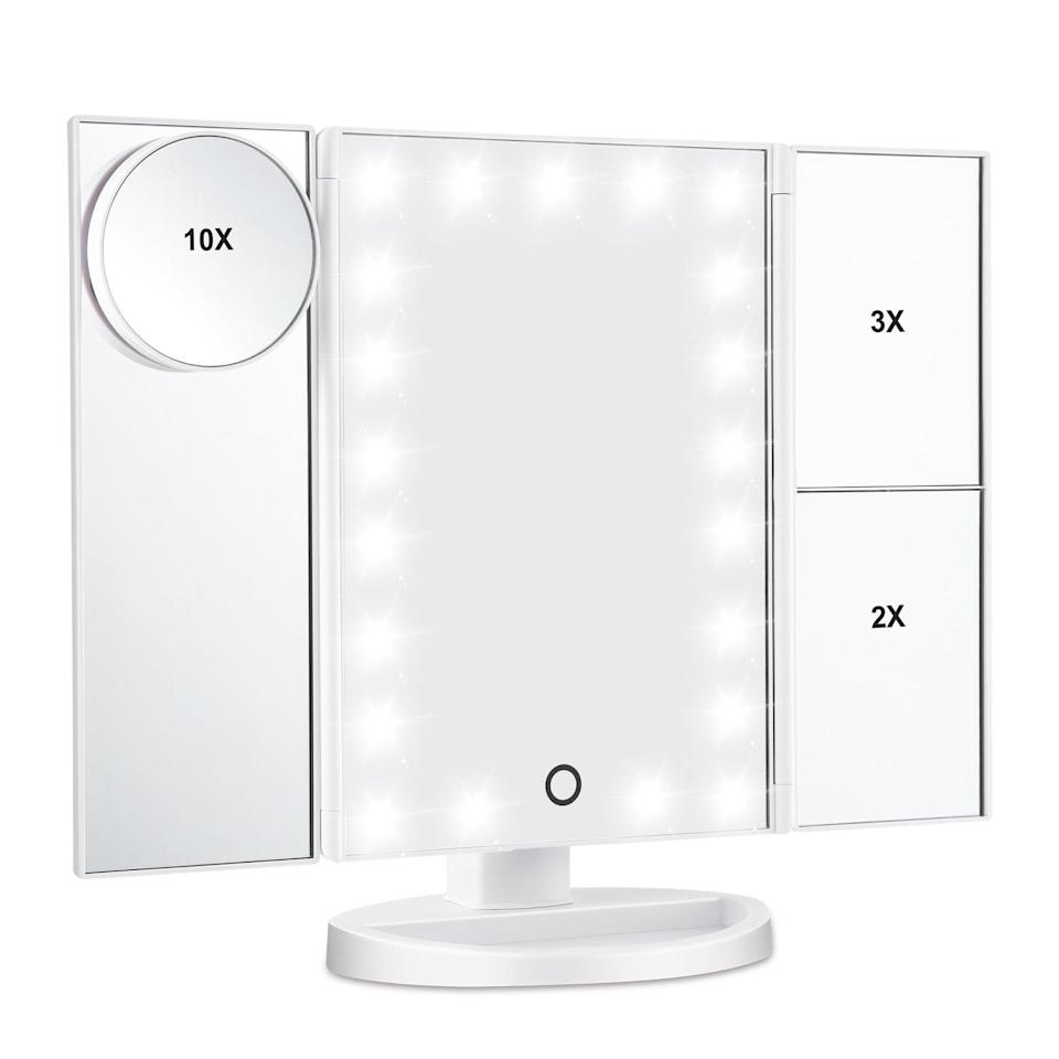 """<p>Doing makeup will feel easier than ever with this handy <a href=""""https://www.popsugar.com/buy/LED-Lighted-Makeup-Mirror-412312?p_name=LED%20Lighted%20Makeup%20Mirror&retailer=walmart.com&pid=412312&price=25&evar1=savvy%3Aus&evar9=45341982&evar98=https%3A%2F%2Fwww.popsugar.com%2Fsmart-living%2Fphoto-gallery%2F45341982%2Fimage%2F46754527%2FLED-Lighted-Makeup-Mirror&list1=shopping%2Cgifts%2Cgadgets%2Cgift%20guide%2Ctech%20shopping%2Ctech%20gifts&prop13=mobile&pdata=1"""" class=""""link rapid-noclick-resp"""" rel=""""nofollow noopener"""" target=""""_blank"""" data-ylk=""""slk:LED Lighted Makeup Mirror"""">LED Lighted Makeup Mirror</a> ($25, originally $50). It features 21 LED bulbs and three different magnification options.</p>"""