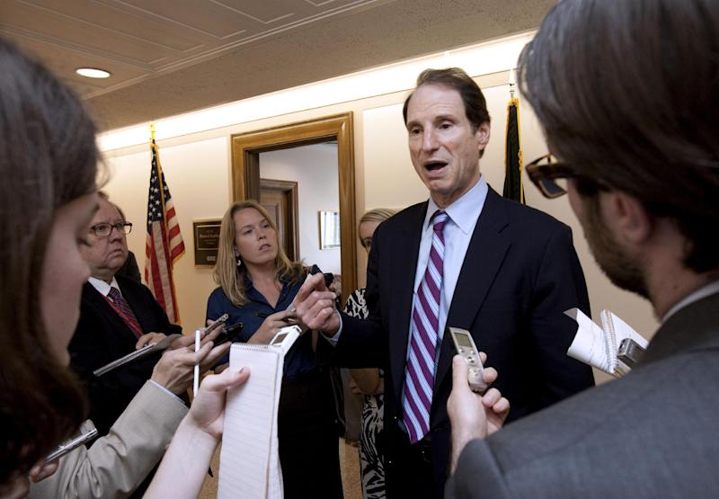 "FILE – In this May 26, 2011 file photo, Sen. Ron Wyden, D-Ore., speaks to reporters on Capitol Hill in Washington. With more than 20 projects to export liquefied natural gas (LNG) under review by the Energy Department, Wyden, chairman of the Senate Energy and Natural Resources Committee, said officials should seek a ""sweet spot"" for LNG exports, allowing enough to spur drilling and increase gas supplies, but not enough to create export-driven price hikes. (AP Photo/Harry Hamburg, File)"
