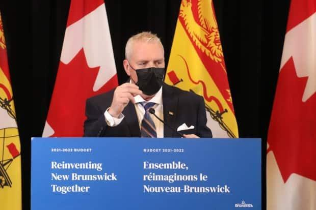 New Brunswick Finance Minister Ernie Steeves reveals details in his government's 2021-2022 fiscal budget during a news conference on Tuesday, March 16.