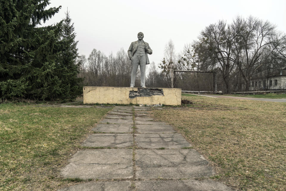 The monument of the Soviet State founder Vladimir Lenin is seen at the Chernobyl exclusion zone, Ukraine, Tuesday, April 13, 2021. TThe vast and empty Chernobyl Exclusion Zone around the site of the world's worst nuclear accident is a baleful monument to human mistakes. Yet 35 years after a power plant reactor exploded, Ukrainians also look to it for inspiration, solace and income. (AP Photo/Evgeniy Maloletka)