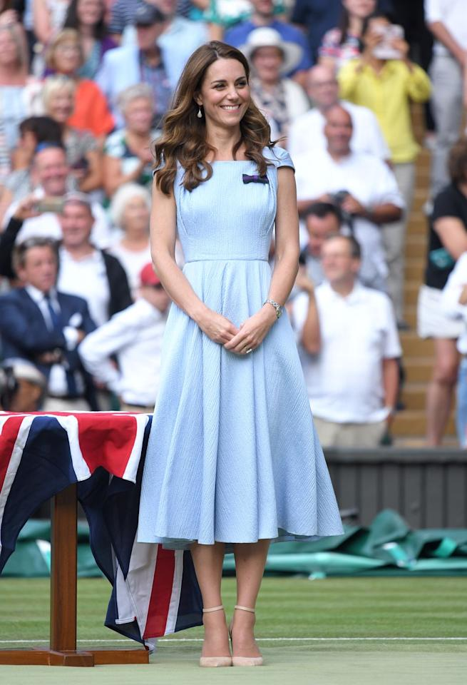 """<p>Kate wore a pretty, <a href=""""https://www.marieclaire.com/fashion/a28388629/kate-middleton-style-fashion-custom-emilia-wickstead-dress-wimbledon/"""" target=""""_blank"""">custom Emilia Wickstead</a> dress for the Men's Finals Day of the Wimbledon Tennis Championships at All England Lawn Tennis and Croquet Club in London. </p>"""