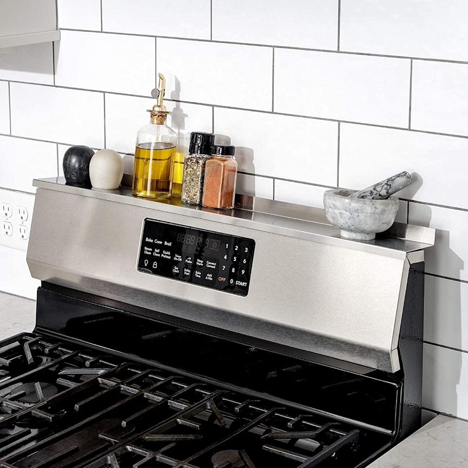 """Keep your most-used seasonings at arm's reach. Who *doesn't* need additional storage space in what is truly the best room in your home?<br /><br /><strong>Promising review:</strong>""""This is amazing and I have no idea I didn't buy one of these years ago!!! My new stove wouldn't get close enough to the wall to allow me to rest anything on top without it falling behind. This was absolutely PERFECT. I am very happy that the magnets provided were able to be moved. This allowed me to place them perfectly for maximum hold because my top was slightly curved."""" —<a href=""""https://www.amazon.com/dp/B0716G9G3X?tag=huffpost-bfsyndication-20&ascsubtag=5883859%2C18%2C54%2Cd%2C0%2C0%2C0%2C962%3A1%3B901%3A2%3B900%3A2%3B974%3A3%3B975%3A2%3B982%3A2%2C16473724%2C0"""" target=""""_blank"""" rel=""""noopener noreferrer"""">JStill</a><br /><br /><strong>Get it from Amazon for<a href=""""https://www.amazon.com/dp/B0716G9G3X?tag=huffpost-bfsyndication-20&ascsubtag=5883859%2C18%2C54%2Cd%2C0%2C0%2C0%2C962%3A1%3B901%3A2%3B900%3A2%3B974%3A3%3B975%3A2%3B982%3A2%2C16473724%2C0"""" target=""""_blank"""" rel=""""noopener noreferrer"""">$39.99</a>(available in four colors).</strong>"""