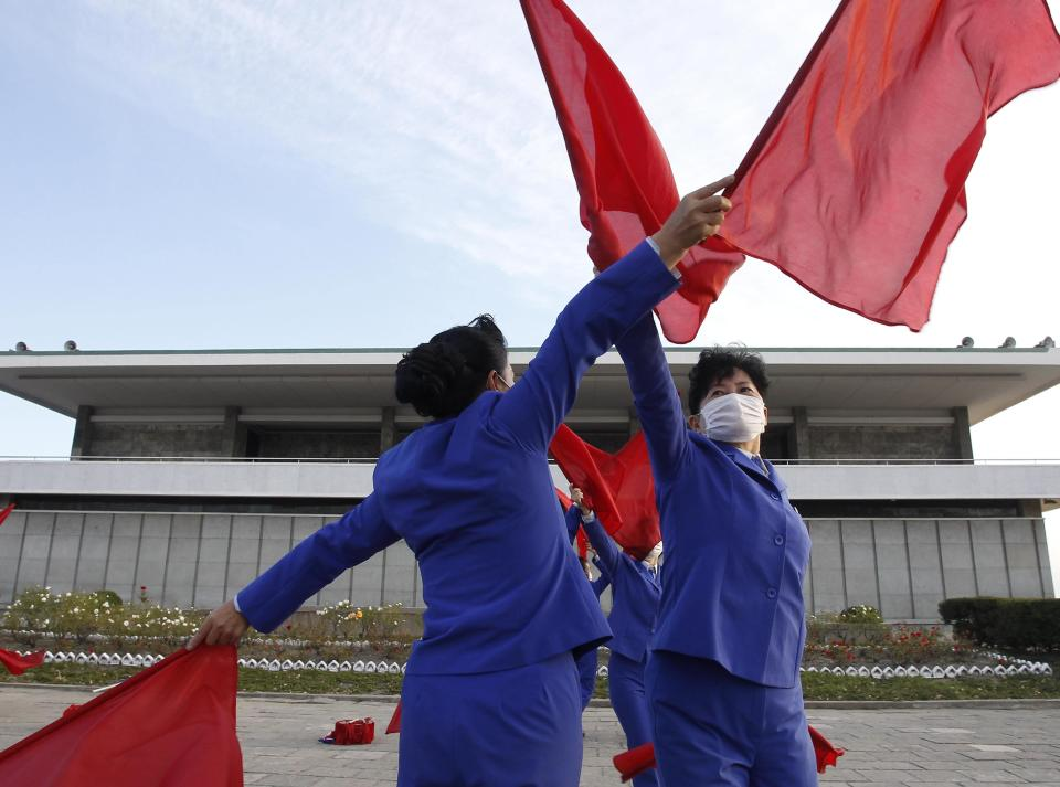 Members of Women's Union in Wonsan city make agitation activities to encourage workers during the rush hour in front of Haean Plaza in the city of Wonsan, Kangwon Province, North Korea DPRK, on Wednesday, Oct., 28, 2020. (AP Photo/Jon Chol Jin)