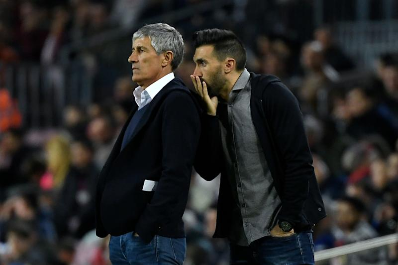 Barcelona's Spanish coach Quique Setien (L) listens to his assistant coach Eder Sarabia during the Spanish league football match between FC Barcelona and Levante UD at the Camp Nou stadium in Barcelona, on February 2, 2020. (Photo by LLUIS GENE / AFP) (Photo by LLUIS GENE/AFP via Getty Images)