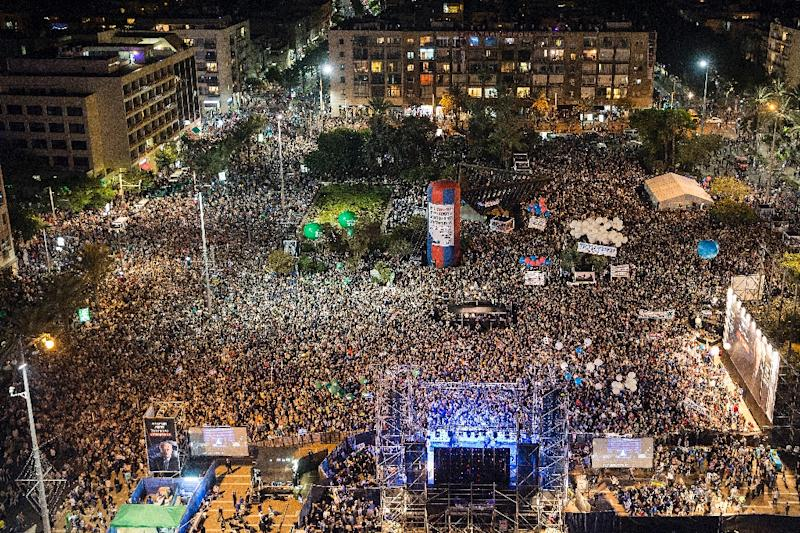 People attend a commemorative rally in memory of late Israeli prime minister Yitzhak Rabin, at Rabin Square in the Israeli coastal city of Tel Aviv on October 31, 2015 (AFP Photo/Jack Guez)