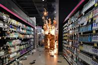 Products burn at a supermarket Carrefour in Sao Paulo, Brazil, on November 20, 2020 after protesters stormed it during a demonstration against racism and the death of a black man beaten by white security agents