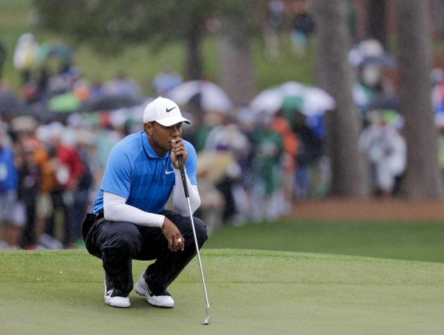 "<a class=""link rapid-noclick-resp"" href=""/pga/players/147/"" data-ylk=""slk:Tiger Woods"">Tiger Woods</a> waits to putt in the rain on the seventh hole during the third round at the Masters golf tournament (AP Photo/David J. Phillip)"