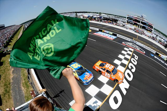 LONG POND, PA - JUNE 10: Joey Logano, driver of the #20 The Home Depot Toyota, leads the field to the start of the NASCAR Sprint Cup Series Pocono 400 presented by #NASCAR at Pocono Raceway on June 10, 2012 in Long Pond, Pennsylvania. (Photo by Jared C. Tilton/Getty Images)