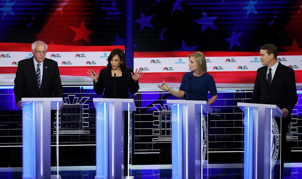 MIAMI, FLORIDA - JUNE 27: Democratic presidential candidates (L-R) Sen. Bernie Sanders (I-VT), Sen. Kamala Harris (D-CA), Sen. Kirsten Gillibrand (D-NY) and Sen. Michael Bennet (D-CO) take part in the second night of the first Democratic presidential debate on June 27, 2019 in Miami, Florida.  A field of 20 Democratic presidential candidates was split into two groups of 10 for the first debate of the 2020 election, taking place over two nights at Knight Concert Hall of the Adrienne Arsht Center for the Performing Arts of Miami-Dade County, hosted by NBC News, MSNBC, and Telemundo. (Photo by Drew Angerer/Getty Images)