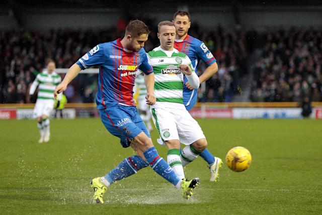 "Football Soccer - Inverness Caledonian Thistle v Celtic - Ladbrokes Scottish Premiership - Tulloch Caledonian Stadium - 29/11/15 Inverness Caledonian Thistle's Danny Devine (L) in action with Celtic's Leigh Griffiths Action Images via Reuters / Graham Stuart Livepic EDITORIAL USE ONLY. No use with unauthorized audio, video, data, fixture lists, club/league logos or ""live"" services. Online in-match use limited to 45 images, no video emulation. No use in betting, games or single club/league/player publications. Please contact your account representative for further details."