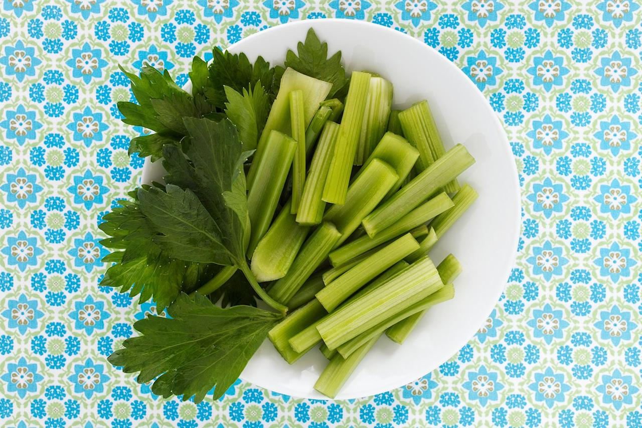 <p>When you don't have the time  -  or, be honest, the patience  -  to brush between meals, munching on celery is a little cheat. This veggie works in a pinch thanks to its fibrous, abrasive texture, which scrapes away yellowing plaque and bits of food stuck in your teeth from lunch. All that chomping revs up the production of cleansing saliva and turns your mouth into a mini cleaning machine.</p><p><strong>TRY THIS: </strong>Fill celery stalks with cottage cheese or sunflower seed butter and enjoy them on days you've eaten carbs that tend to get lodged in your teeth, like pretzels or crackers. These can become erosion-triggering sugars if you don't brush them away</p><p><strong>MORE NATURAL CLEANERS:</strong> Apples, carrots, cucumber, radishes</p>