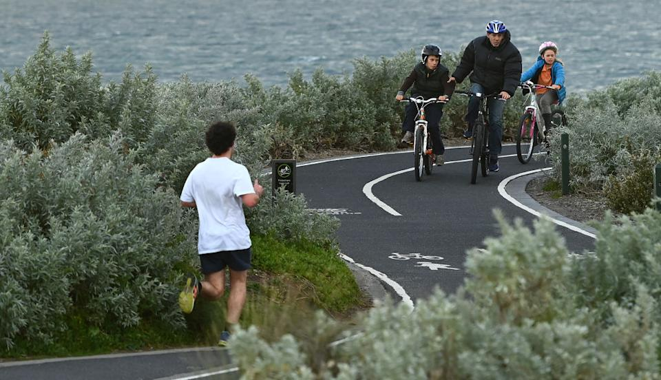 Melburnians exercise along Elwood Beach in Melbourne.