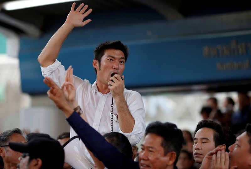 Juangroongruangkit of Thailand's progressive Future Forward Party talks to his supporters during an unauthorized flash mob rally in Bangok