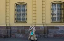 Two nuns wearing face masks walk in Santiago, Chile
