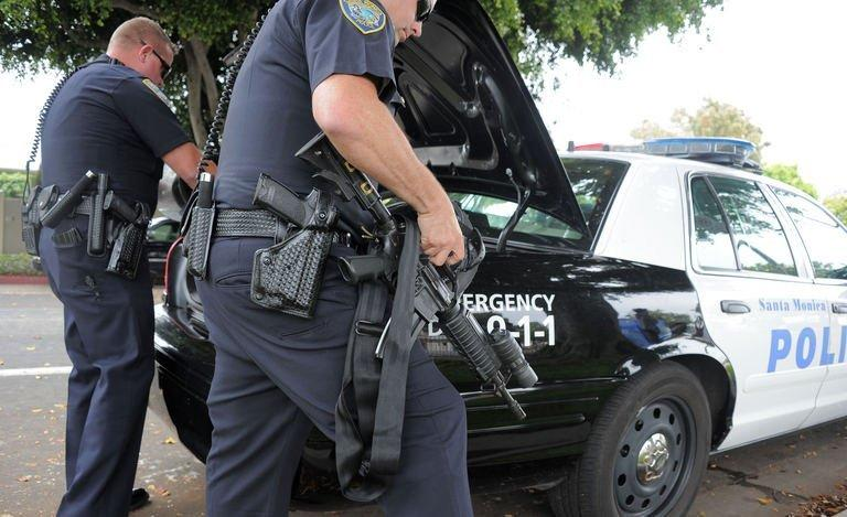 Police arrive on the grounds of Santa Monica College on June 7, 2013 in Santa Monica, California. At least six people died in a shooting rampage in California on Friday, before police shot and killed a black-clad gunman in a college library, police said