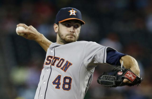 Houston Astros' Jarred Cosart throws against the Arizona Diamondbacks during the first inning of a baseball game on Monday, June 9, 2014, in Phoenix. (AP Photo/Ross D. Franklin)