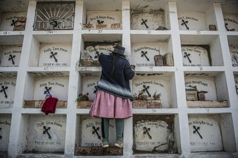 The remains of the Lucanamarca massacre victims lie in a white mausoleum in the local cemetery (AFP/Ernesto BENAVIDES)