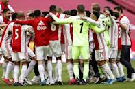 Ajax players celebrate after winning their 35th national title