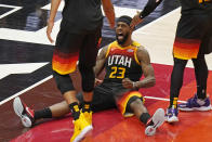 Utah Jazz forward Royce O'Neale (23) reacts after being fouled by Los Angeles Clippers forward Kawhi Leonard during the first half of Game 2 of a second-round NBA basketball playoff series Thursday, June 10, 2021, in Salt Lake City. (AP Photo/Rick Bowmer)