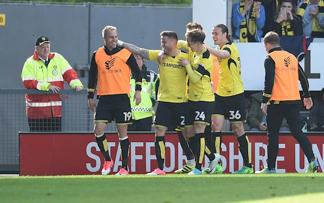 Michael Kightly celebrates scoring for Burton - Rex Features