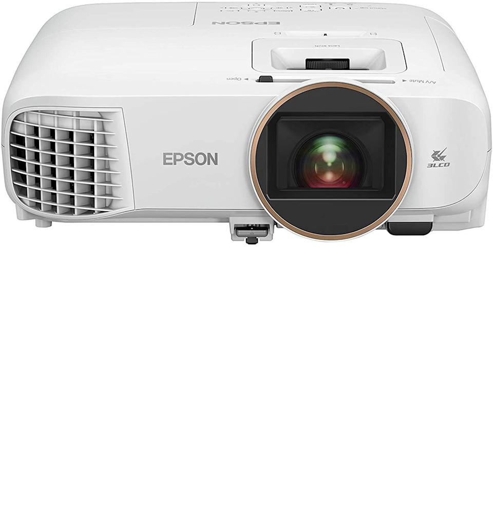 """<p><strong>Epson</strong></p><p>amazon.com</p><p><strong>$999.99</strong></p><p><a href=""""https://www.amazon.com/dp/B08GL4GB2M?tag=syn-yahoo-20&ascsubtag=%5Bartid%7C10054.g.36461922%5Bsrc%7Cyahoo-us"""" rel=""""nofollow noopener"""" target=""""_blank"""" data-ylk=""""slk:Buy"""" class=""""link rapid-noclick-resp"""">Buy</a></p><p>I'll be honest with you. I use a 1080p projector at home for gaming, not 4K. And (forgive me, gamers) I can't really tell the difference. Sure, there are times when a 4K image is noticeably superior. But keep in mind, the Nintendo Switch still doesn't even output at 4K. The screen on the little Switch console? It's 720p. This Epson projector, which comes in at less than a thousand bucks, only goes as high as 1080p, but unless you need military-grade pixel-accuracy, I don't think it really matters. Especially not for gaming! In a dark room, this projector is crystal clear and packs a serious punch when it comes to brightness: 2,700 lumens. That's pretty damn bright for only a thousand smackaroos!</p>"""