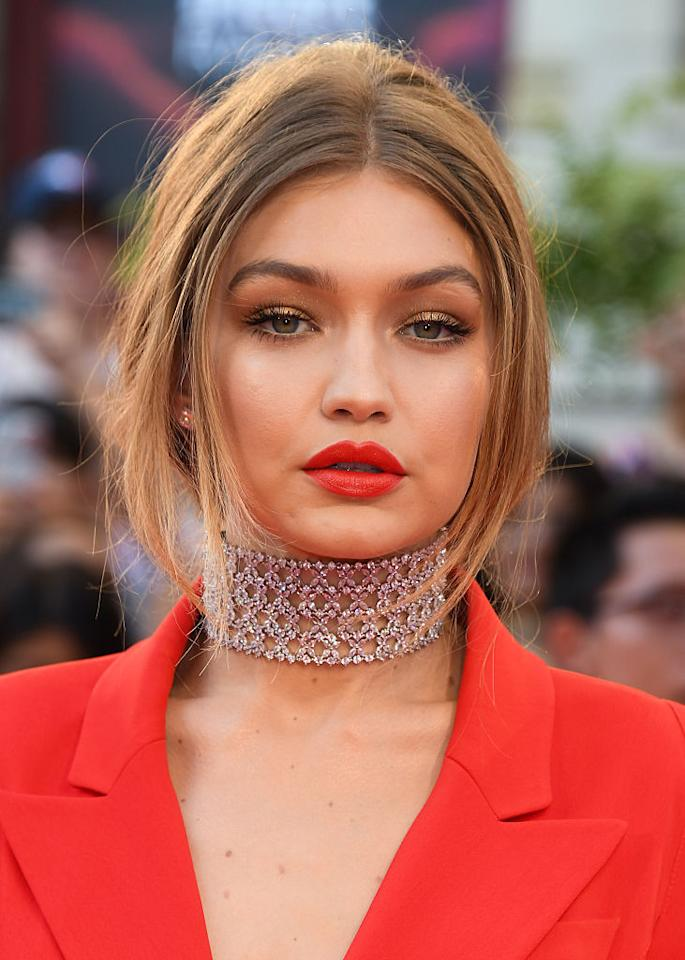 "<p>According to Maybelline makeup artist Patrick Ta, who did Gigi's makeup for the show, the 21-year-old wanted ""a bronze and beautiful eye with a bold aspect to it, which was the red lip."" Mission accomplished! <i>(Photo by George Pimentel/WireImage)</i></p>"