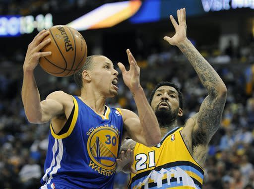 Golden State Warriors guard Stephen Curry, left, drives against Denver Nuggets guard Wilson Chandler, right, in the second quarter of Game 1 in the first round of the NBA basketball playoffs on Saturday, April 20, 2013, in Denver. (AP Photo/Chris Schneider)