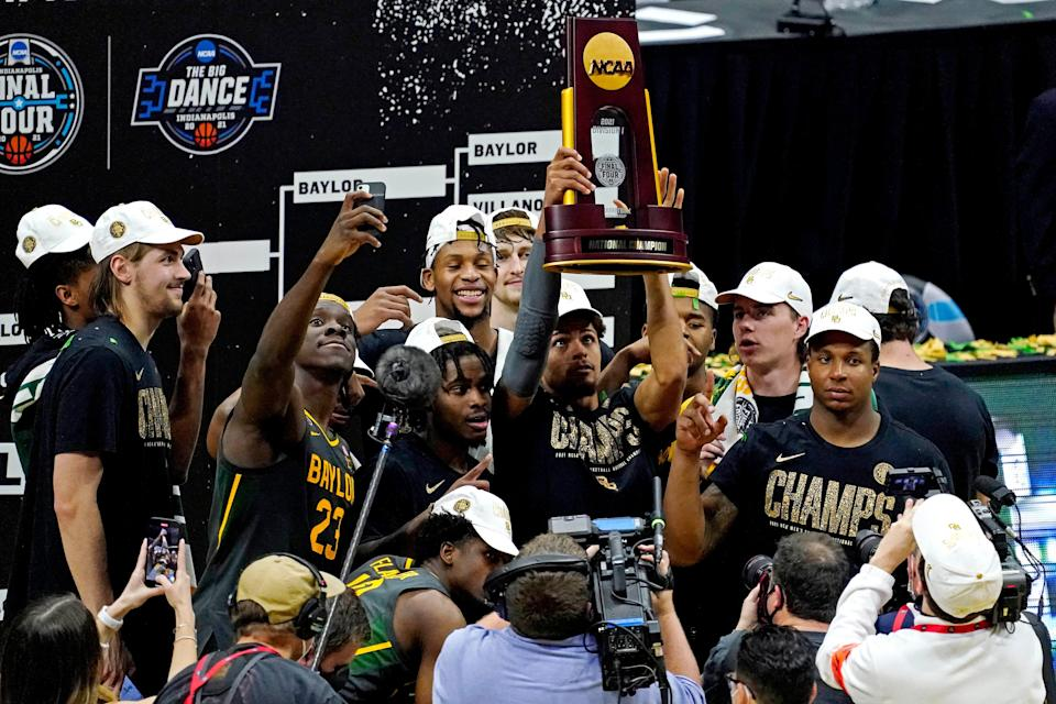 Baylor players celebrate after beating the Gonzaga  in the national championship game during the Final Four of the 2021 NCAA Tournament at Lucas Oil Stadium.