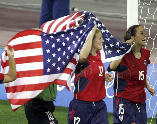 FILE - In this Aug. 26, 2004, file photo, USA's players Cindy Parlow (12) and Kate Markgraf (15) celebrate defeating Brazil in the gold medal match at the Athens 2004 Olympics in Greece. Cindy Parlow Cone, who scored 75 goals over an 11-year career with the U.S. womens national team, will be inducted into the National Soccer Hall of Fame, announced Thursday, May 31, 2018. (AP Photo/Diether Endlicher, File)