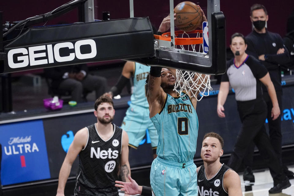 Charlotte Hornets forward Miles Bridges (0) dunks during the second half of the team's NBA basketball game against the Brooklyn Nets, Friday, April 16, 2021, in New York. (AP Photo/Mary Altaffer)