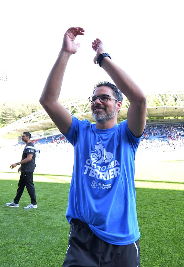 "Soccer Football - Premier League - Huddersfield Town vs Arsenal - John Smith's Stadium, Huddersfield, Britain - May 13, 2018 Huddersfield Town manager David Wagner applauds the fans at the end of the match REUTERS/Peter Powell EDITORIAL USE ONLY. No use with unauthorized audio, video, data, fixture lists, club/league logos or ""live"" services. Online in-match use limited to 75 images, no video emulation. No use in betting, games or single club/league/player publications. Please contact your account representative for further details."
