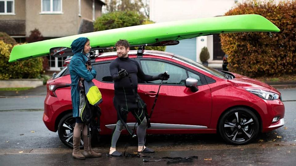 A car with a canoe on the roof