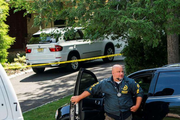 PHOTO: Law enforcement are seen officials outside the home of federal judge Esther Salas, where her son was shot and killed and her defense attorney husband was critically injured, in North Brunswick, N.J., July 20, 2020. (Eduardo Munoz/Reuters)