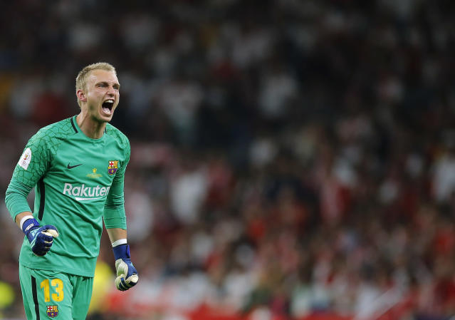 Barcelona goalkeeper Jasper Cillessen celebrates after Luis Suarez scoring his side's opening goal during the Copa del Rey final soccer match between Barcelona and Sevilla at the Wanda Metropolitano stadium in Madrid, Spain, Saturday, April 21, 2018. (AP Photo/Paul White)