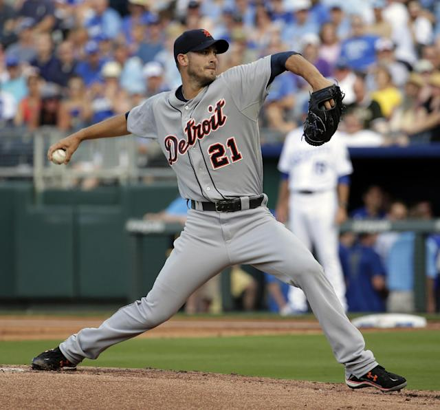 Detroit Tigers starting pitcher Rick Porcello throws during the first inning of a baseball game against the Kansas City Royals Saturday, July 12, 2014, in Kansas City, Mo. (AP Photo/Charlie Riedel)